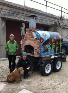 Jess Karen and Mandy (dog) warming up the pizza oven