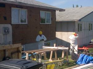 Brandon Energy Efficiency Program (BEEP) workers renovating inner city homes in Brandon